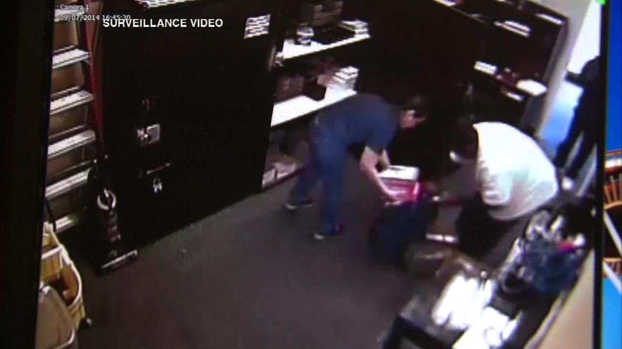 A brazen store robbery is caught on surveillance video that appears to show two men robbing a suburban T-Mobile store.