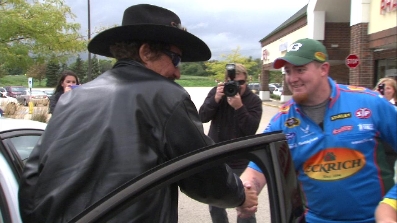 Richard Petty drove up in a 2014 Ford Fusion that was then given to vet Raymond Goss and his family.