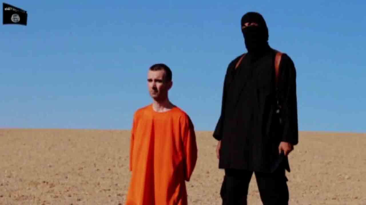 A graphic video posted online Saturday, Sept. 13, 2014 purports to show the beheading of British aid worker David Haines by a self-professed member of ISIS.