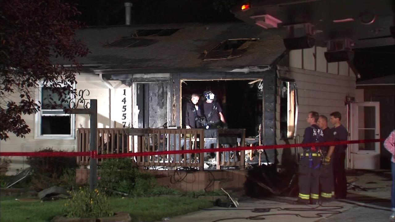 A woman was taken to Loyola University Medical Center in critical condition after a fire in suburban Orland Park.