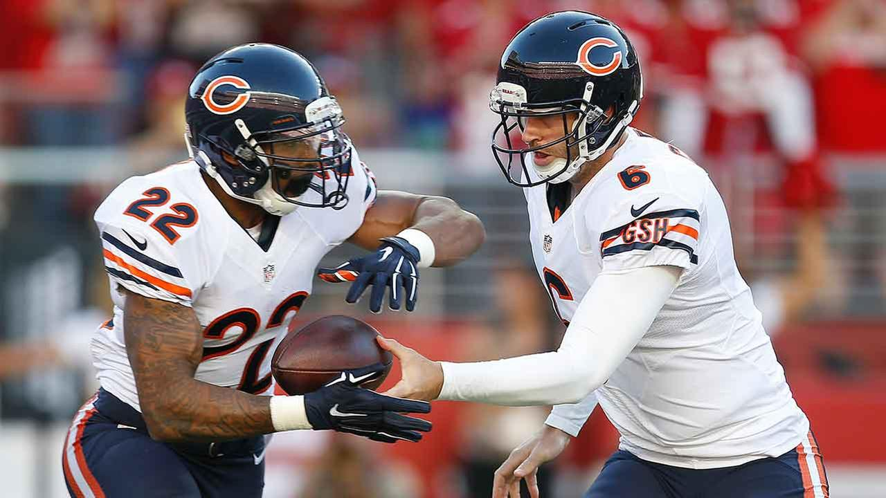 Chicago Bears quarterback Jay Cutler (6) hands off to running back Matt Forte (22) during the first quarter of an NFL football game against the San Francisco 49ers.