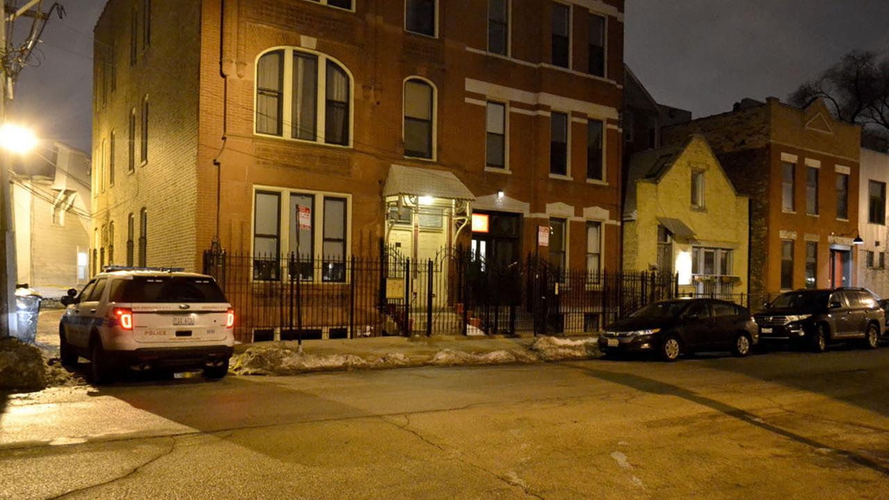 Chicago Police guard a Wicker Park alley early Friday after a 14-year-old boy was wounded in a drive-by shooting.