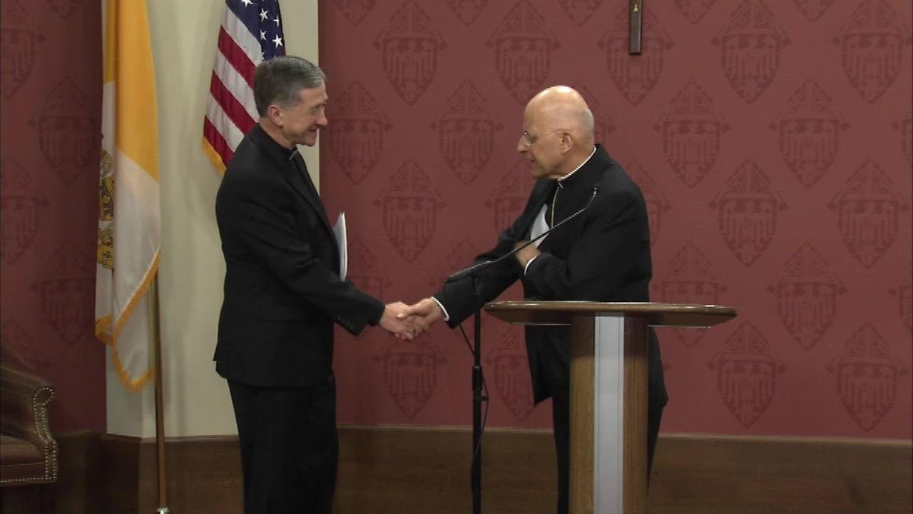 Archbishop-Designate Blase Cupich and Francis Cardinal George shake hands after Cupich is introduced.