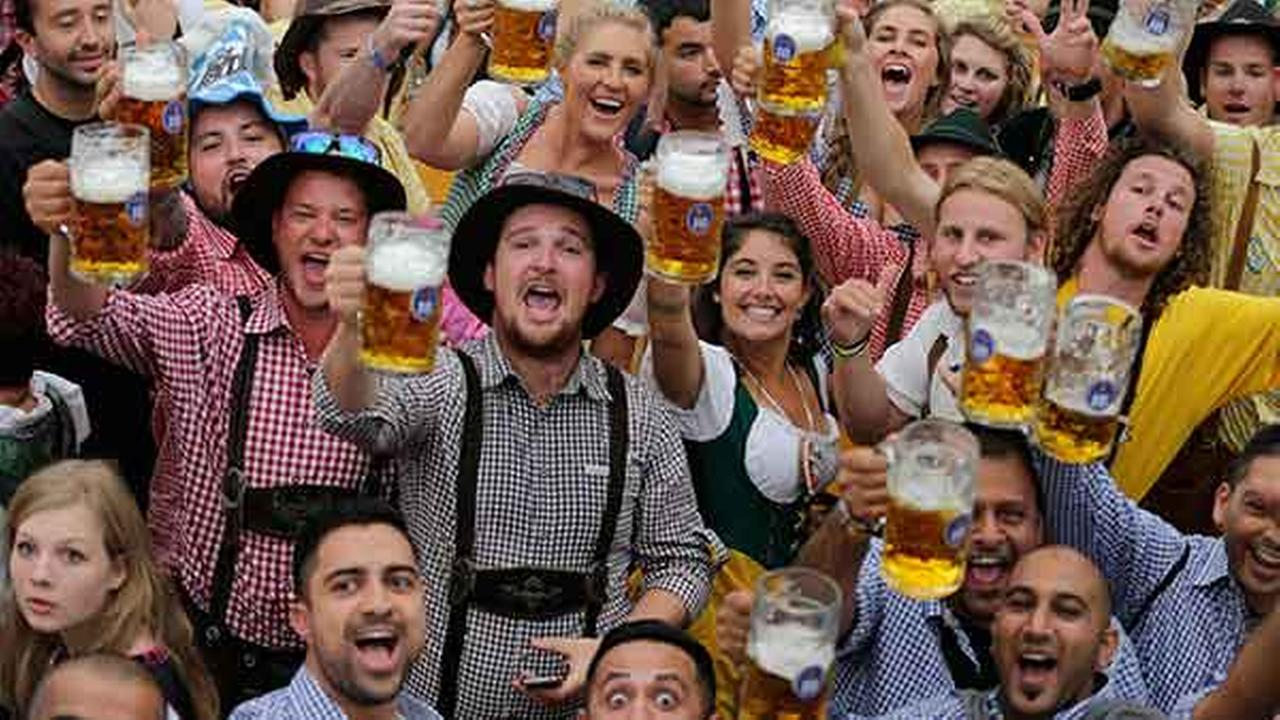 People celebrate the opening of the 181st Oktoberfest beer festival in Munich, southern Germany, Saturday, Sept. 20.