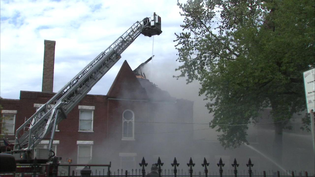 Firefighters battled a two-alarm fire at a church in Chicagos Austin neighborhood on Saturday, Sept. 20, 2014.