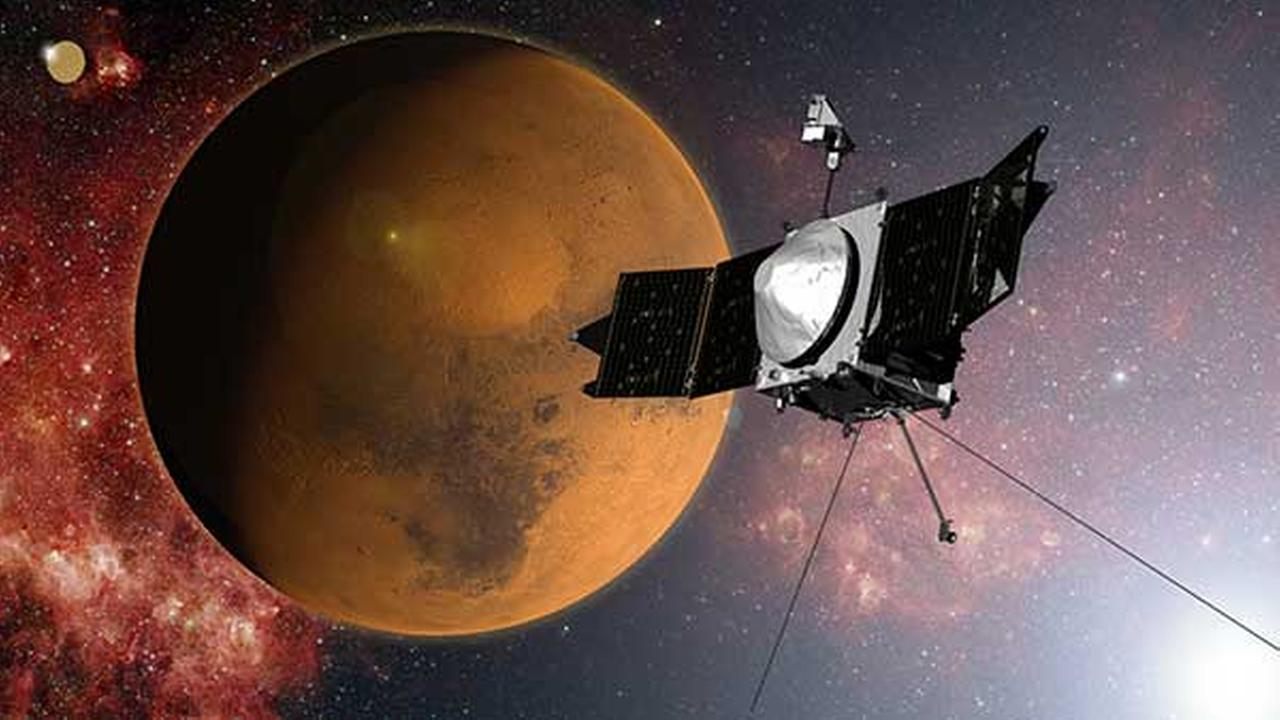 In this artist concept provided by NASA, the MAVEN spacecraft approaches Mars on a mission to study its upper atmosphere.