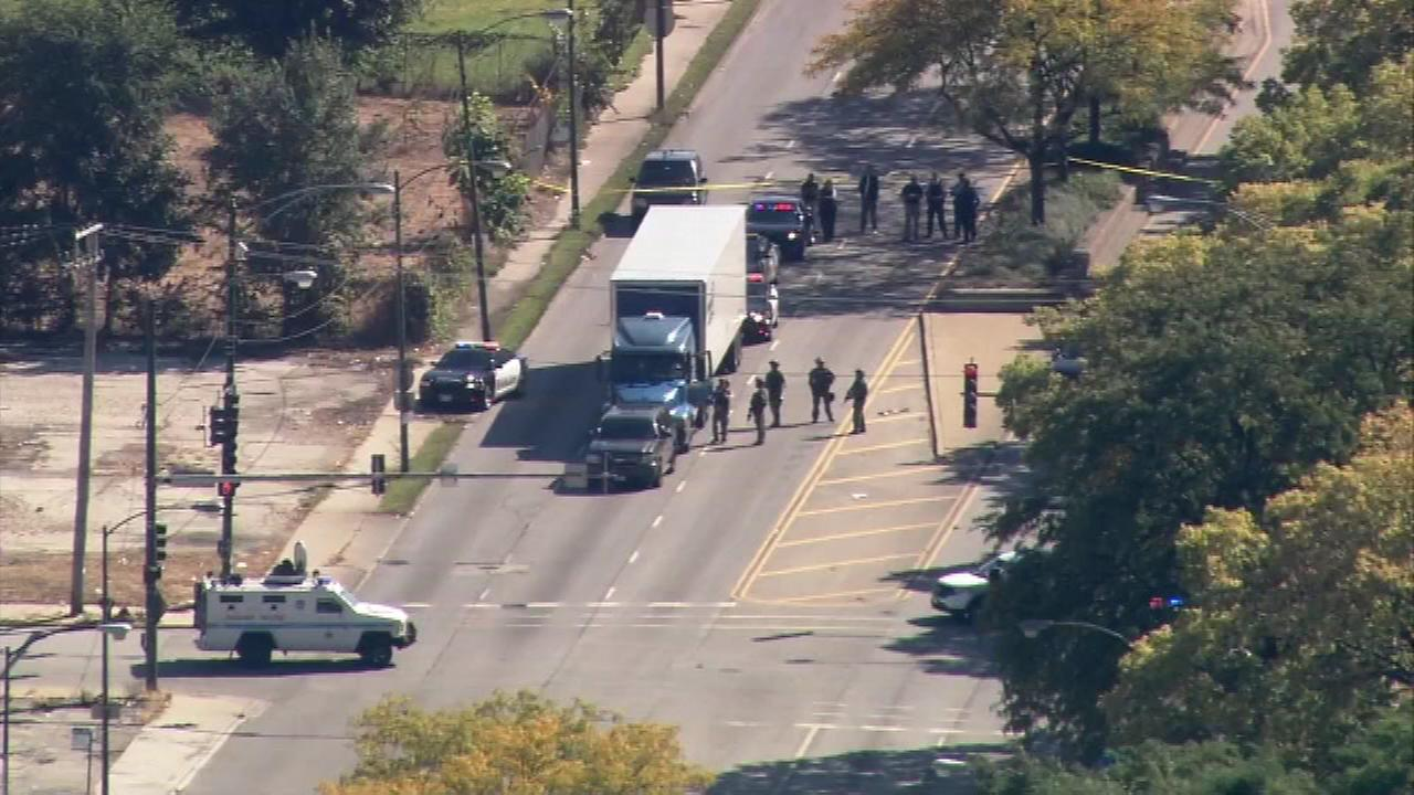 A man was taken into police custody after barricading himself and two children inside a box truck on Cicero Avenue near 43rd Street.