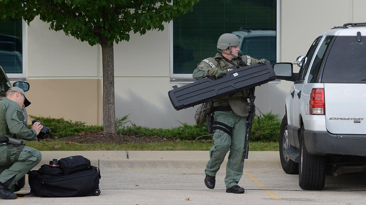 SWAT teams at Brewster Creek Business Park in Bartlett, Ill.