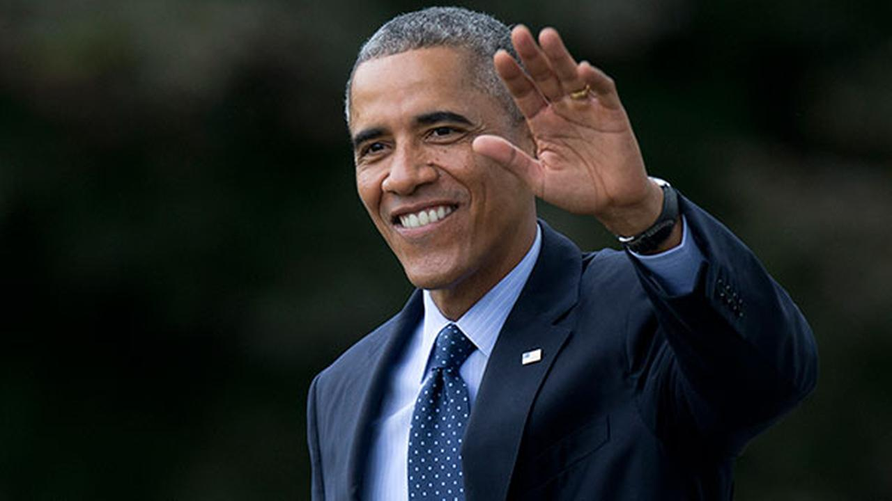 President Barack Obama waves as he walks across the South Lawn of the White House in Washington on Oct. 7, 2014.