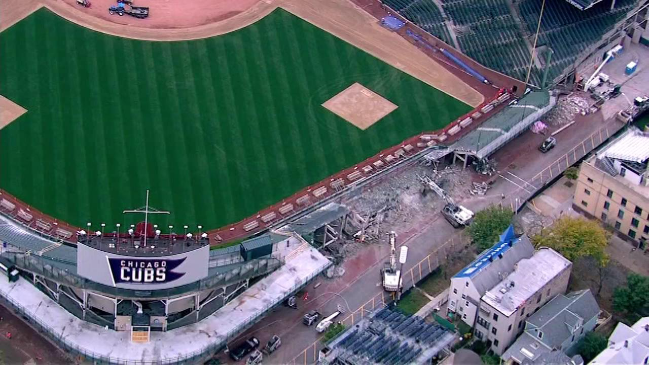 The walls and bleachers really are tumbling down at Wrigley Field, as the demolition is in full swing.
