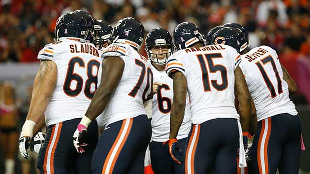 Chicago Bears quarterback Jay Cutler calls a play in huddle against the Atlanta Falcons during a game on Oct. 12, 2014, in Atlanta.