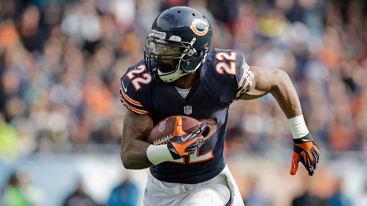 Chicago Bears running back Matt Forte (22) rushes for a touchdown against the Miami Dolphins.