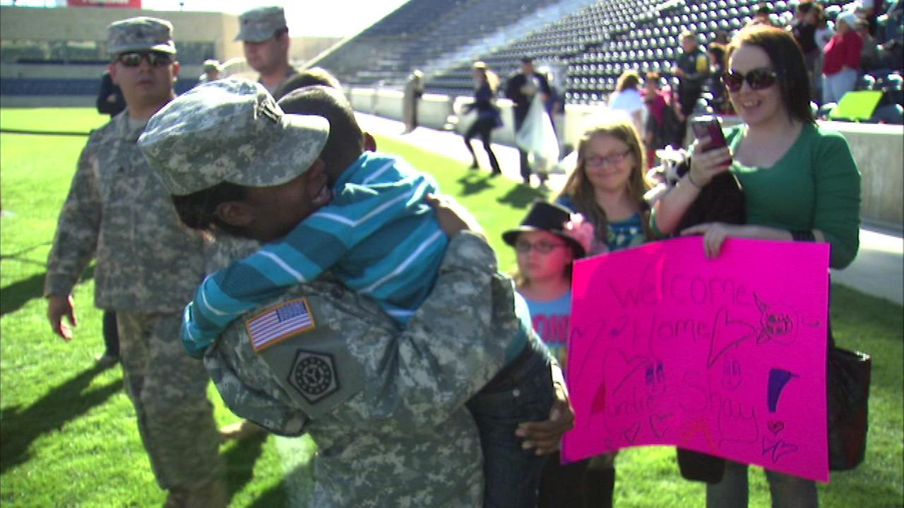 An Illinois Army National Guard soldier gets a big welcome home after serving in Kuwait.