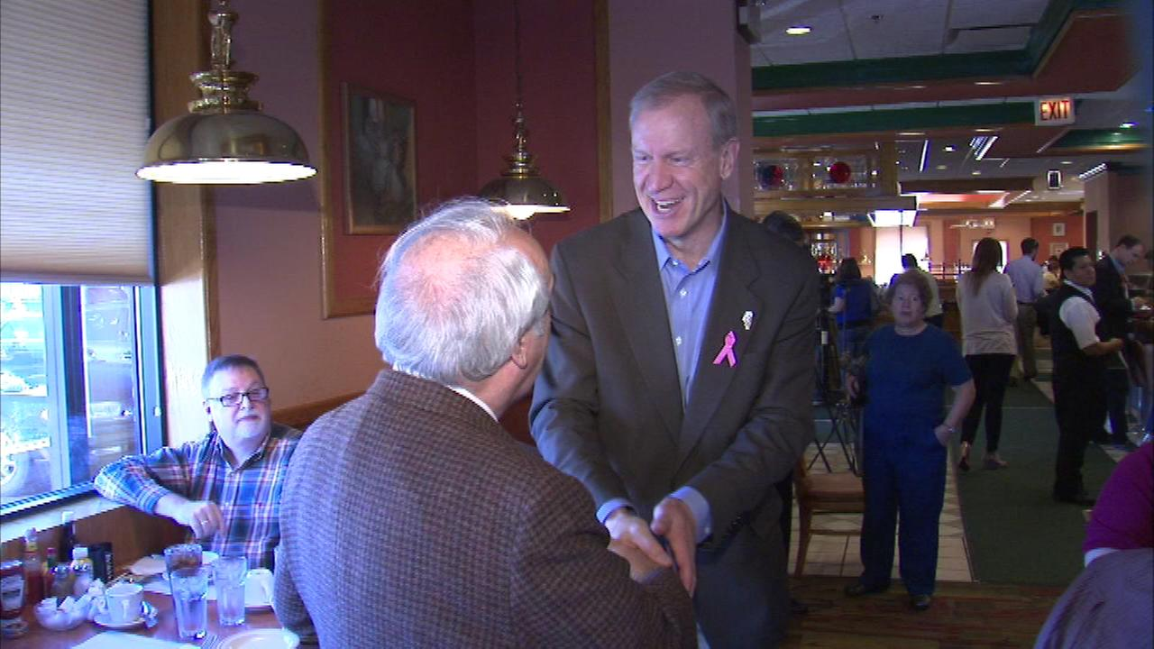 Republican candidate for Illinois governor Bruce Rauner greets voters at a restaurant in north suburban Morton Grove Saturday.