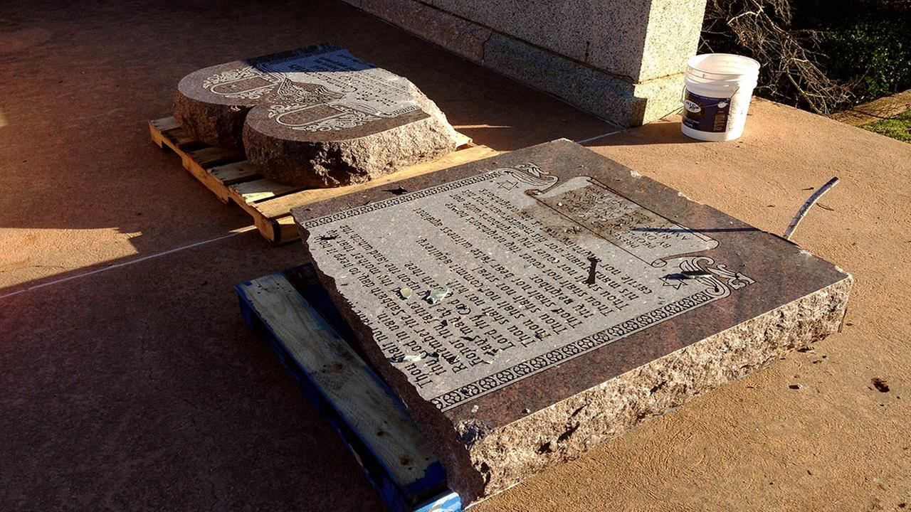 The damaged remains of a Ten Commandments monument are gathered on the Oklahoma State Capitol grounds Friday, Oct. 24, 2014 in Oklahoma City.