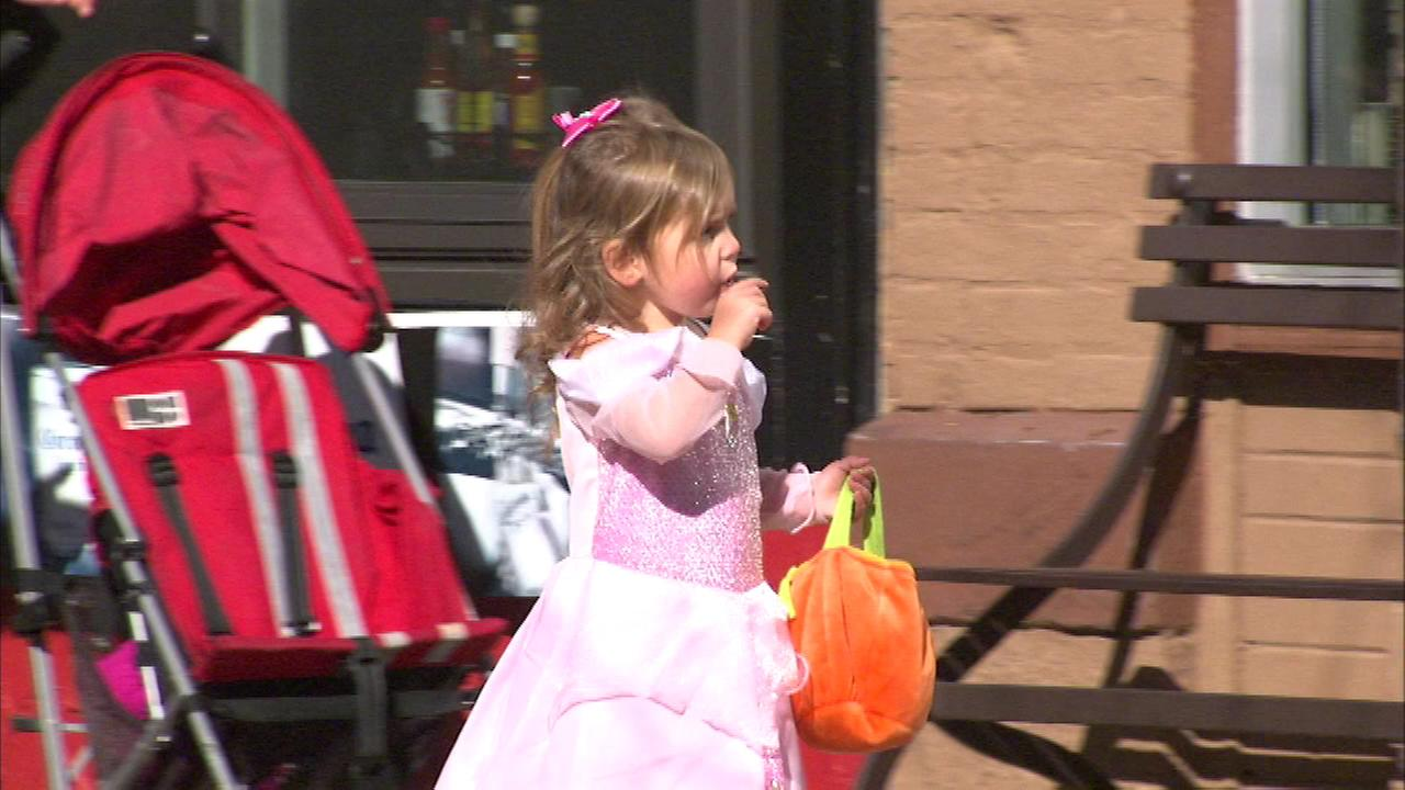 Trick-or-treaters descended on Naperville, where several streets were closed to traffic to help keep little ghouls and goblins safe.