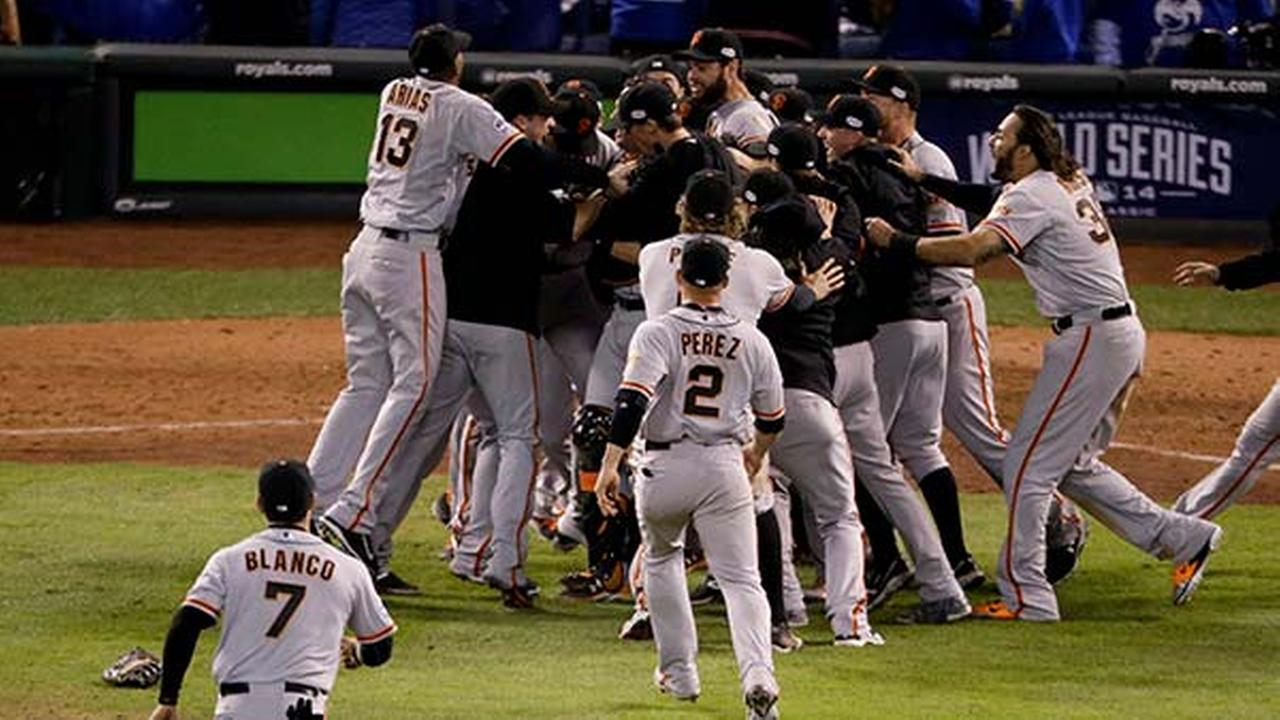 Members of the San Francisco Giants celebrate their 3-2 win against the Kansas City Royals in Game 7 of baseballs World Series Wednesday, Oct. 29, 2014, in Kansas City, Mo.