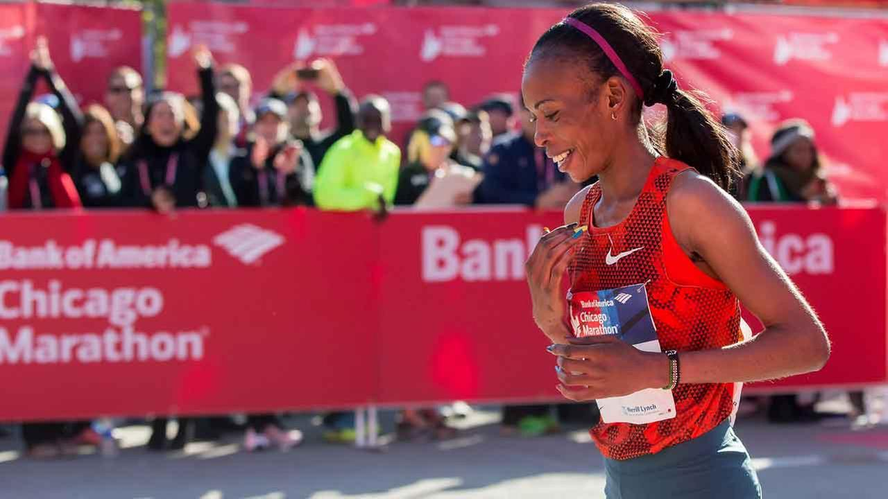 (FILE) Rita Jeptoo of Kenya crosses the finish line to win the womens race at the Chicago Marathon in Chicago on October 12, 2014.