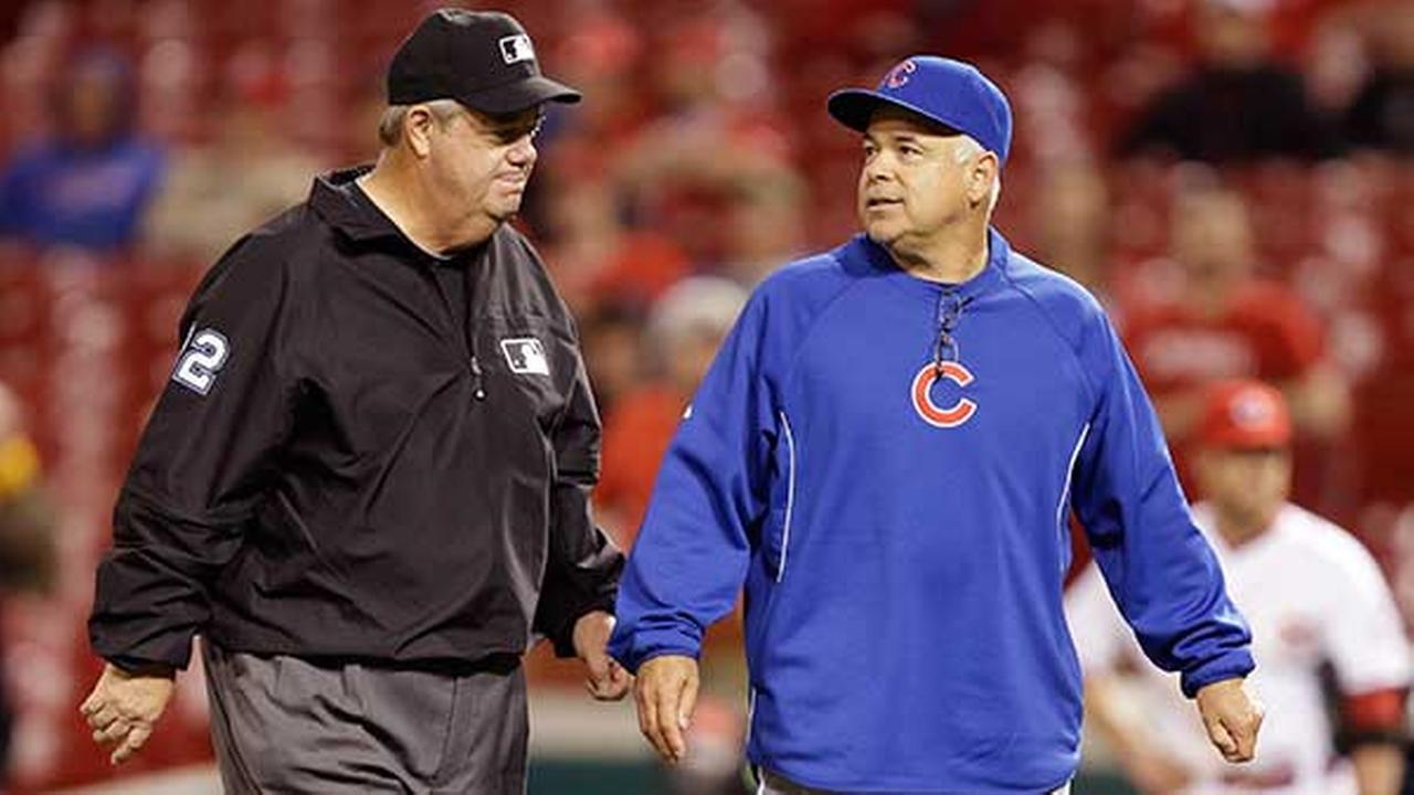 Chicago Cubs manager Rick Renteria, right, questions a call with umpire Joe West during a baseball game against the Cincinnati Reds, April 30, 2014, in Cincinnati.