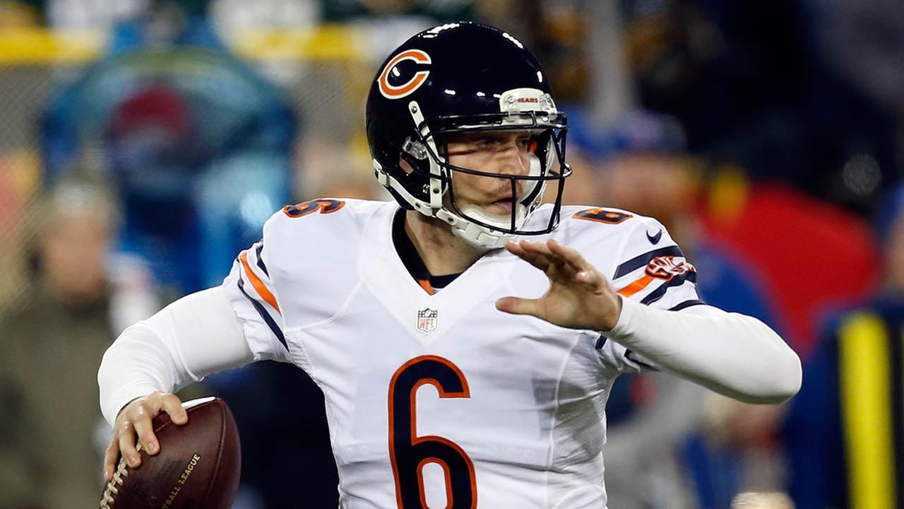 Chicago Bears quarterback Jay Cutler (6) looks for a receiver during the first half of an NFL football game.
