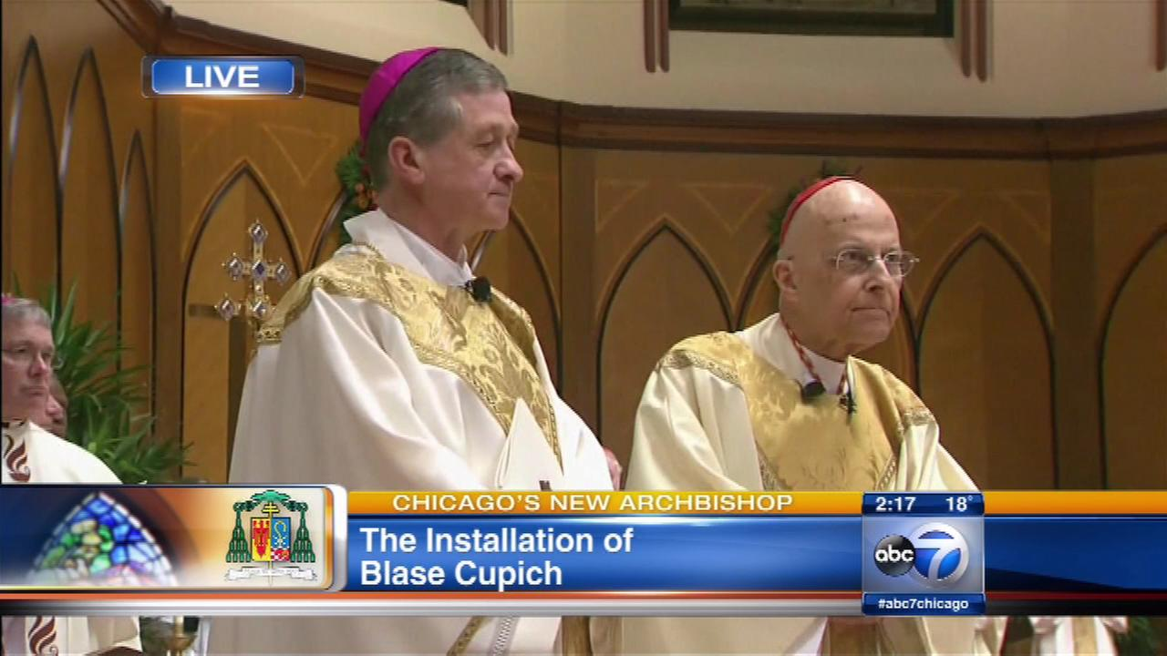 Cardinal George stands alongside Archbishop Blase Cupich during his installation as the new archbishop of Chicago on Nov. 18, 2014.