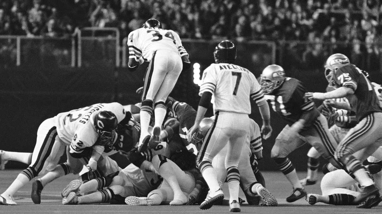 Walter Payton, 34, jumps during a Bears game after a hand-off from Bob Avellini, 7, in 1978.