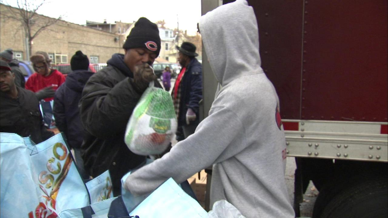 Hundreds of frozen turkeys are given away Saturday during an annual holiday event on Chicagos South Side.