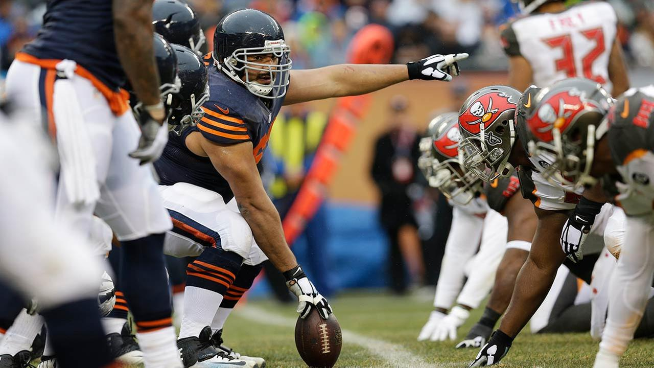Chicago Bears center Roberto Garza (63) prepares to snap the ball against the Tampa Bay Buccaneers during the first half of an NFL football game Sunday, Nov. 23, 2014, in Chicago.