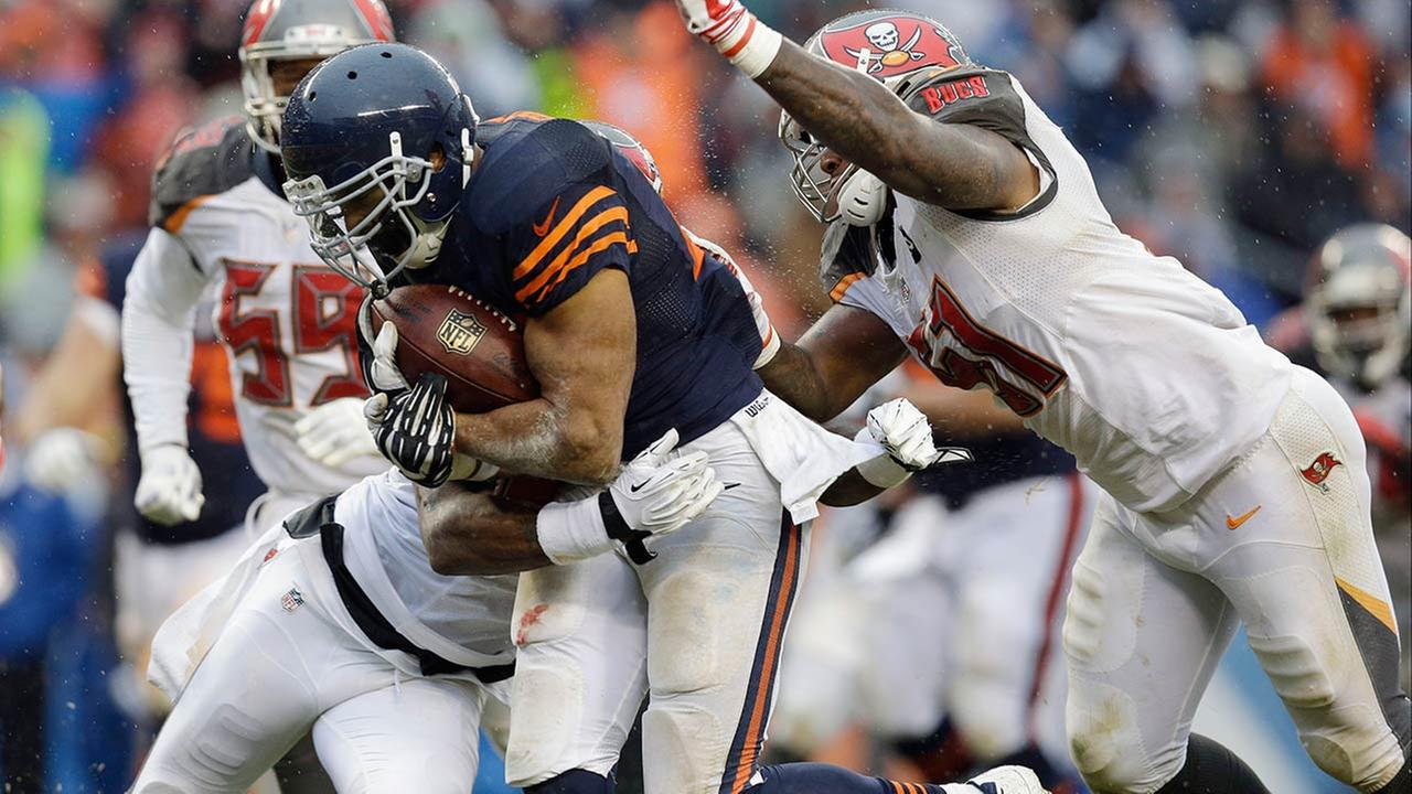 Chicago Bears running back Matt Forte carries the ball into the end zone for a touchdown during the second half of an NFL football game Sunday, Nov. 23, 2014, in Chicago.