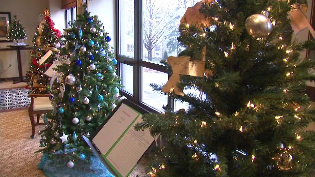 The Rotary Club in west suburban Oak Park held its annual holiday tradition where handcrafted wreaths and trees, complete with decorations, are bid on during a silent auction.