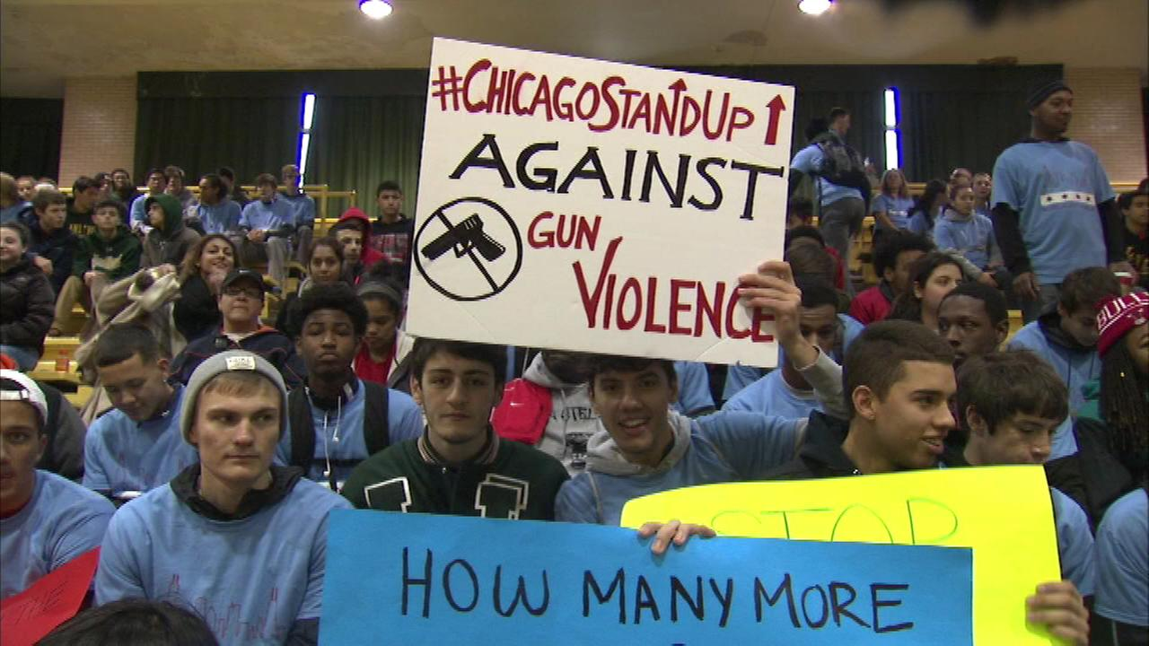 Hundreds of Lane Tech High School students gathered at their North Side school to stand up against gun violence.