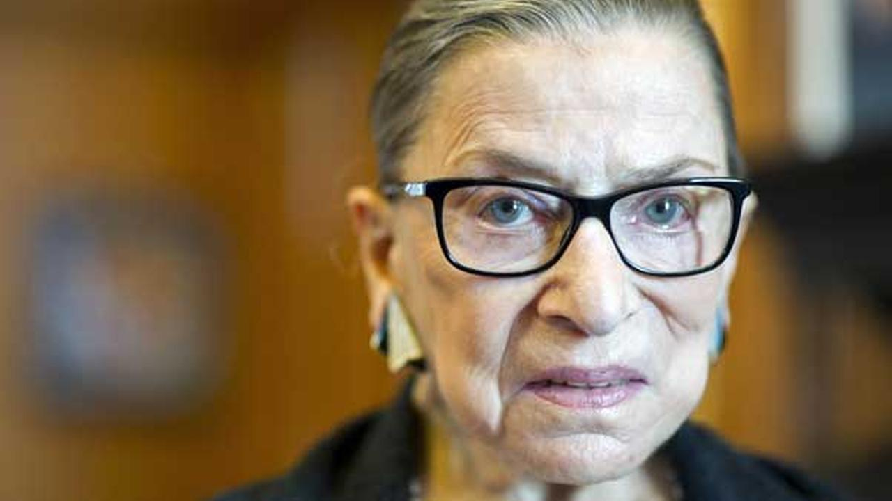 In this July 31, 2014 file photo is Associate Justice Ruth Bader Ginsburg in her Supreme Court chambers in Washington.