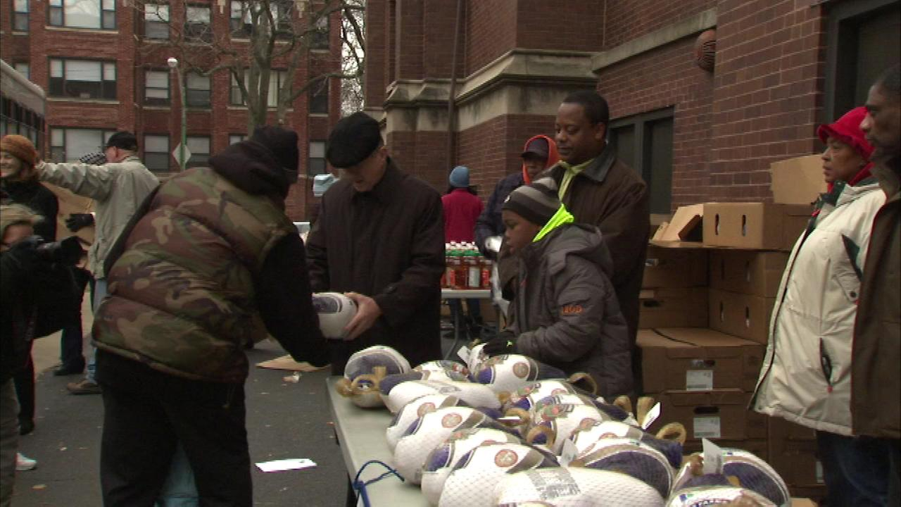 Chicagos new archbishop is continuing his tradition of giving back to the community by handing out some Thanksgiving turkeys Wednesday.