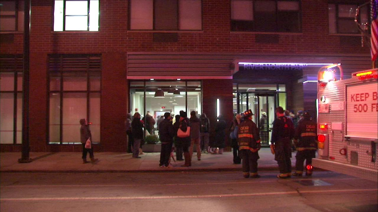The fire was contained on the 4th floor of a 24-story building in the 300-block of W. Illinois, officials said.
