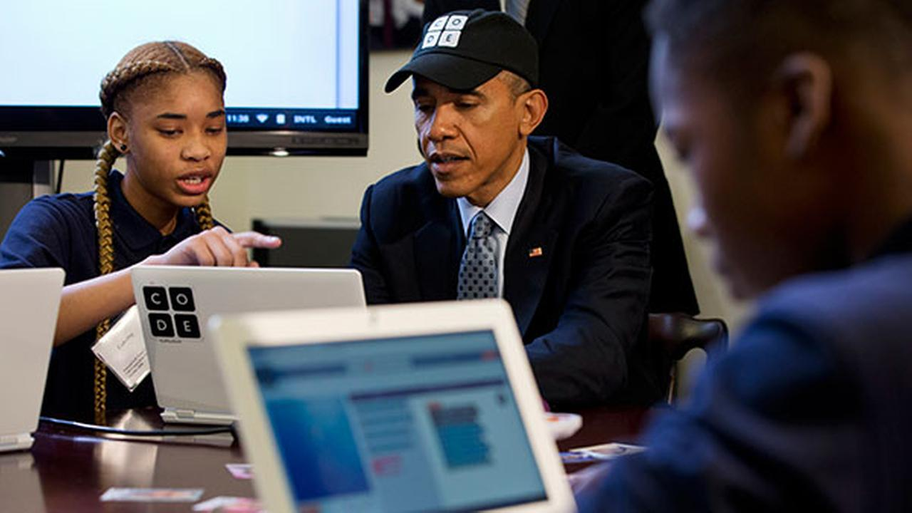 Adrianna Mitchell explains a coding learning program to President Barack Obama during an Hour of Code event on Dec. 8, 2014, attended by middle-school students from Newark, N.J.
