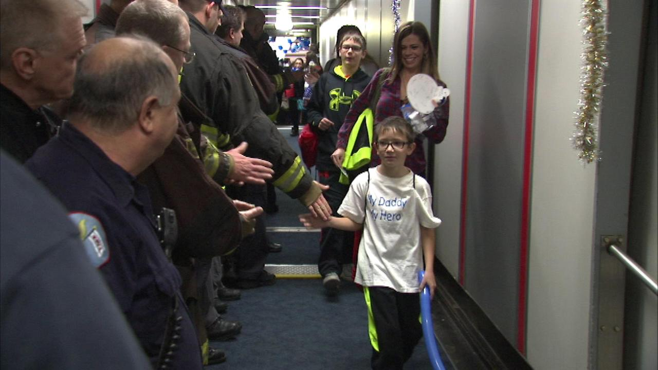 Hundreds of children from across the country boarded the Snowball Express Thursday on a trip to create happy memories.