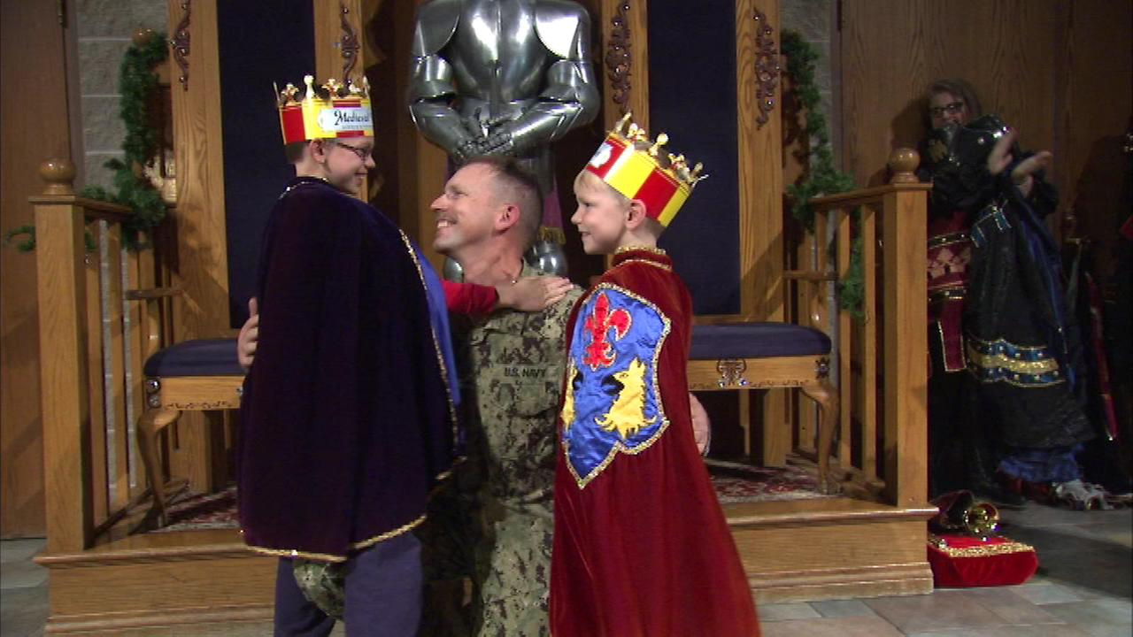 Two boys who thought they would see some jousting during a visit to Medieval Times Friday night got a big surprise from their dad, back from Afghanistan.