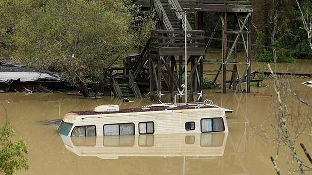 An RV sits underwater from the flooded Russian River Dec. 12, 2014, in Guerneville, Calif.