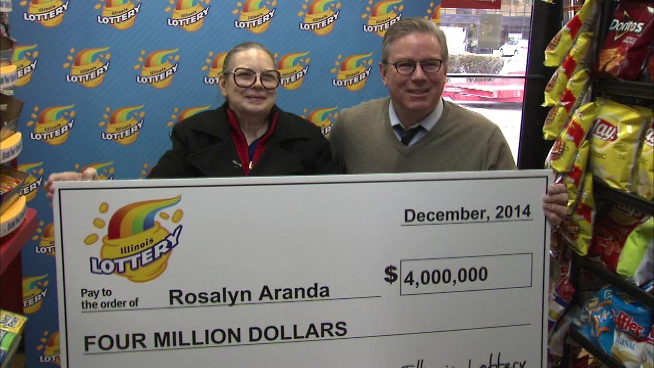 Rosalyn Aranda showed off a giant check signifying her $4 million Illinois Lottery windfall.