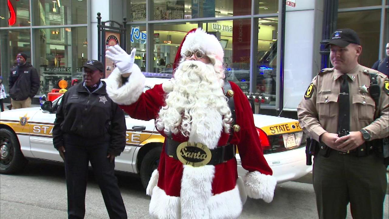 Santa and Mrs. Claus received a police escort as they delivered gifts to the children of Chicago officers killed or seriously injured on the job.