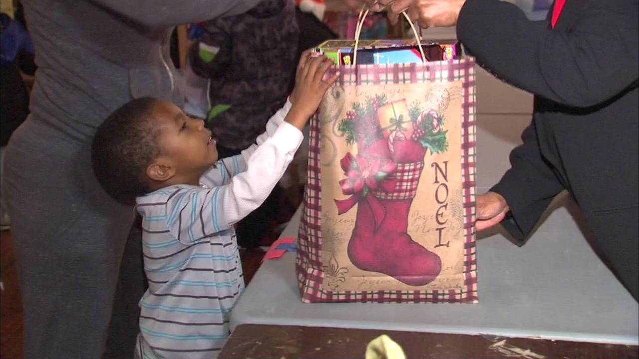 About 2,000 needy children celebrated Christmas a bit early at a toy giveaway Saturday afternoon in the citys Englewood neighborhood.