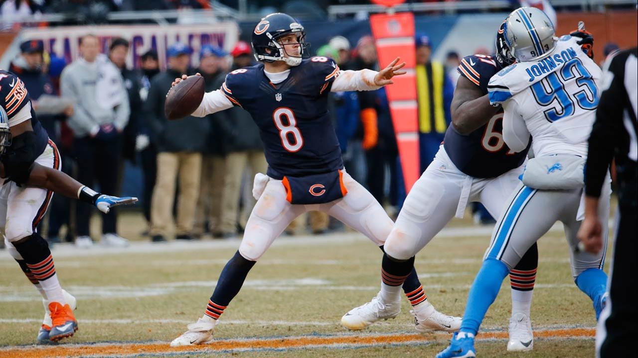 Chicago Bears quarterback Jimmy Clausen (8) passes against the Detroit Lions in the second half of an NFL football game Sunday, Dec. 21, 2014, in Chicago.