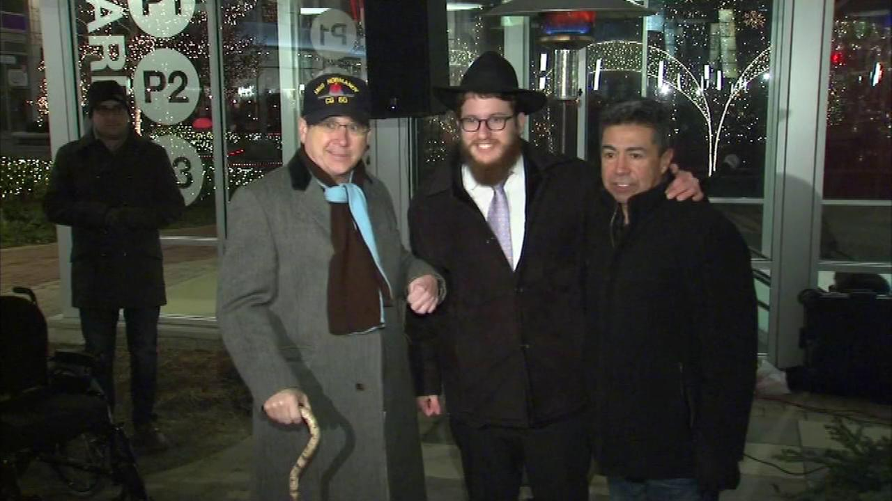 Senator Mark Kirk and Alderman Danny Soliz joined Rabbi Leibel Moscowitz for a menorah lighting at the Roosevelt Collection Mall Sunday.