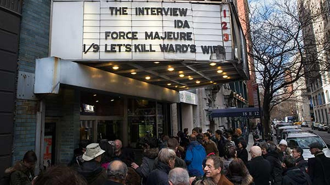 Patrons wait in line to see The Interview at the Cinema Village movie theater, Thursday, Dec. 25, 2014, in New York. T