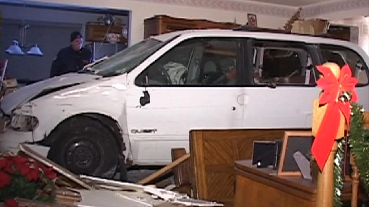 A van crashed into a house in the west suburbs, rolled through two rooms and into the third before stopping Thursday night.