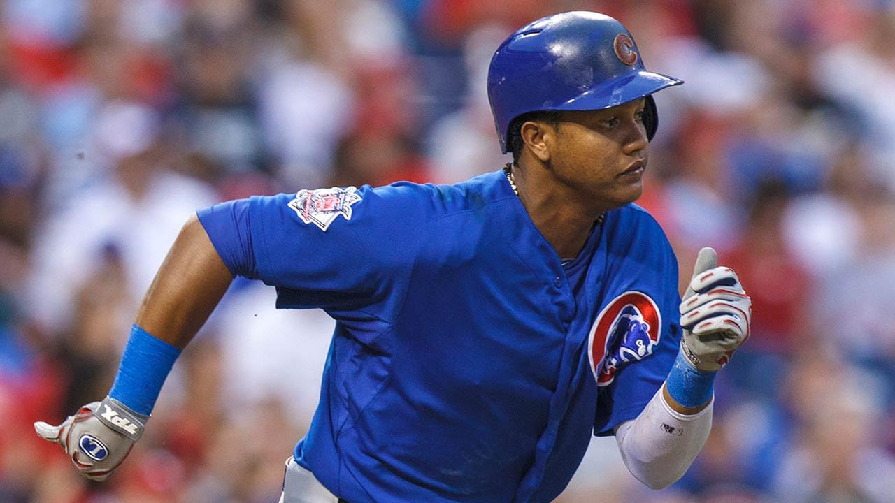 Chicago Cubs Starlin Castro runs to first base during the fourth inning of a baseball game, Wednesday, Aug. 7, 2013, in Philadelphia.