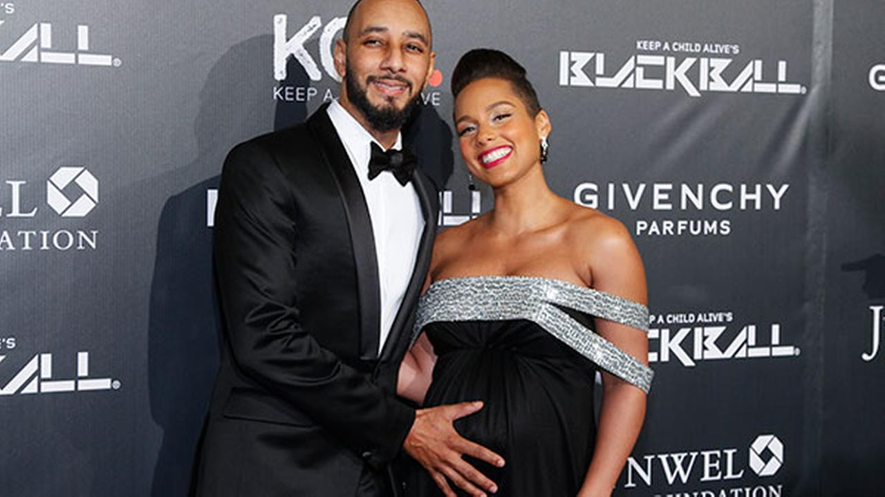 Swizz Beatz, left, and Alicia Keys, attend Keep a Child Alives 2014 Black Ball at the Hammerstein Ballroom on Thursday, Oct. 30, 2014.