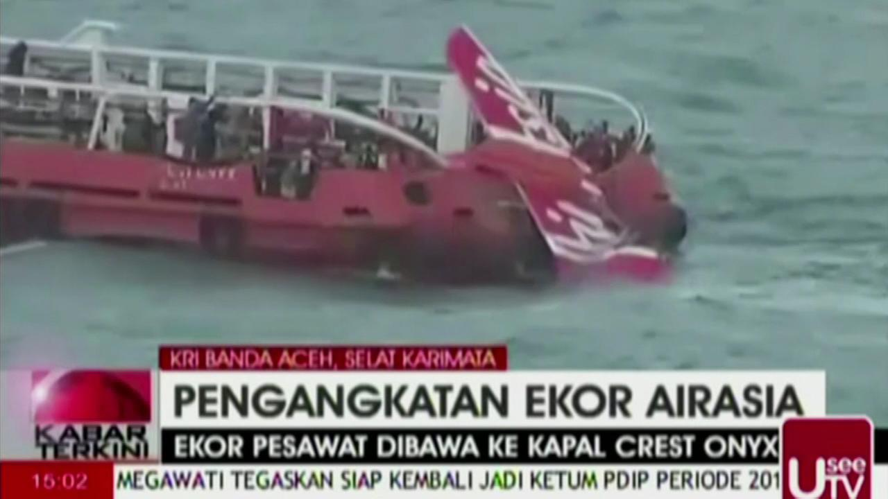 Airasia Jet S Tail Lifted From Sea No Black Boxes Found