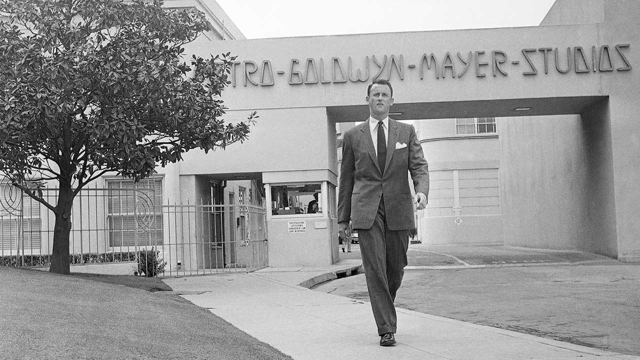 FILE - In this April 22, 1959, file photo, Samuel Goldwyn, Jr., poses outside the main gate at Metro-Goldwyn-Mayer studios in the Hollywood section of Los Angeles.AP Photo/Ellis R. Bosworth, File