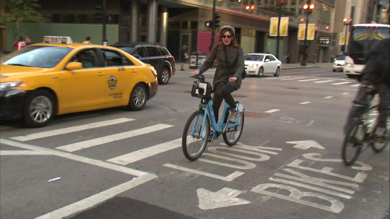 Chicagos popular Divvy bike-sharing program is expanding to the suburbs in 2015.